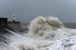 © Licensed to London News Pictures. 12/10/2018. Porthcawl, Bridgend, Wales, UK. Storm Callum hits the small Welsh seaside town of Porthcawl in Bridgend, UK. Photo credit: Graham M. Lawrence/LNP