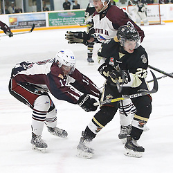 "TRENTON, ON  - MAY 4,  2017: Canadian Junior Hockey League, Central Canadian Jr. ""A"" Championship. The Dudley Hewitt Cup. Game 6 between Trenton Golden Hawks and the Dryden GM Ice Dogs. Connor Quinn #27 of the Trenton Golden Hawks deflects the shot as Cory Dennis #12 and  Cody Wardner #20 of the Dryden GM Ice Dogs defend the net.<br /> (Photo by Tim Bates / OJHL Images)"