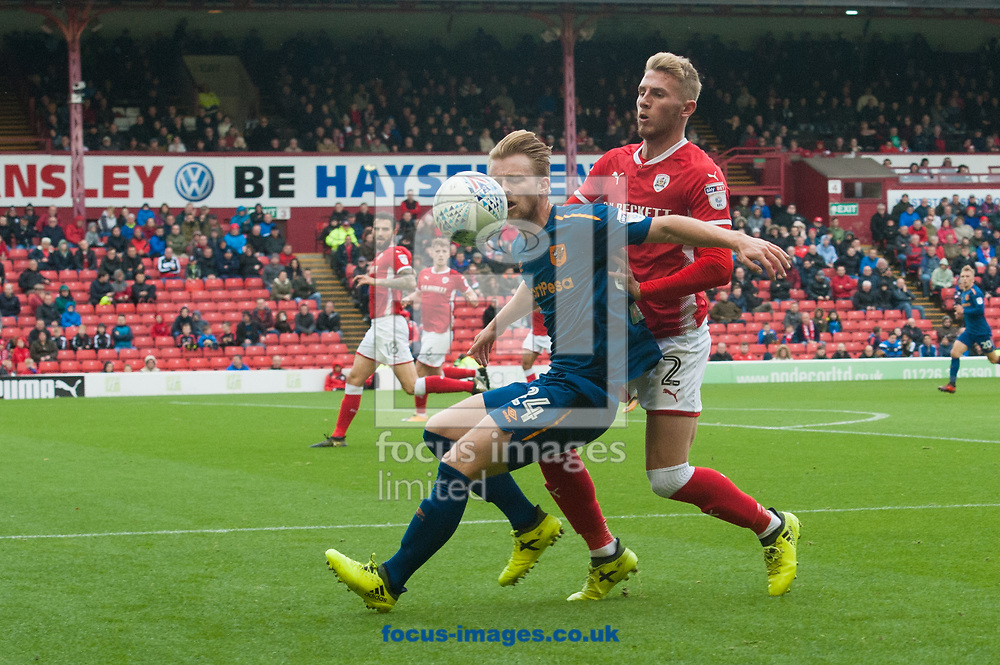 Max Clark of Hull City holds up the ball ahead of Jason McCarthy of Barnsley during the Sky Bet Championship match at Oakwell, Barnsley<br /> Picture by Matt Wilkinson/Focus Images Ltd 07814 960751<br /> 21/10/2017
