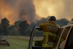 July 31, 2018 - Lakeport, California, U.S. - TOM BISSELL, firefighter medic from Downey, watches the fire approach near Hendricks Road on Tuesday, July 31, 2018 west of Lakeport. Mendocino Complex fires had burned 90,212 acres by Wednesday morning, Cal Fire said. (Credit Image: © Jose Luis Villegas/Sacramento Bee via ZUMA Wire)