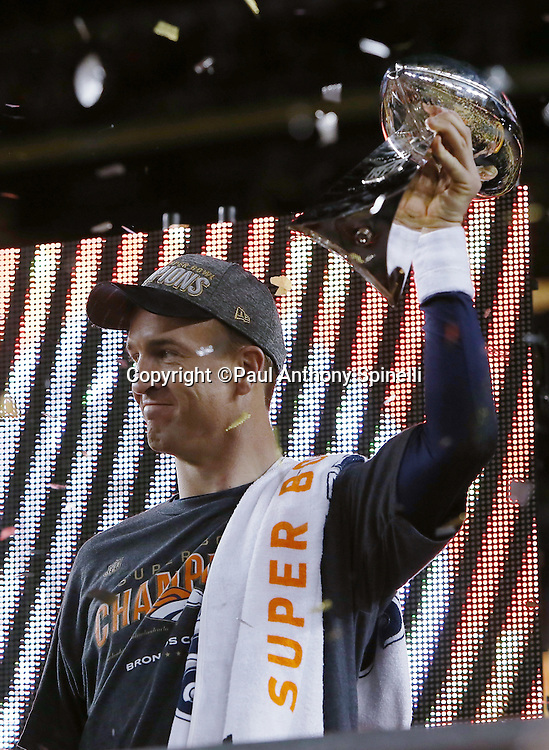 Denver Broncos quarterback Peyton Manning (18) celebrates while holding the Lombardi Trophy in the air after winning the NFL Super Bowl 50 football game against the Carolina Panthers on Sunday, Feb. 7, 2016 in Santa Clara, Calif. The Broncos won the game 24-10. (©Paul Anthony Spinelli)