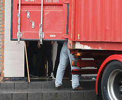 The legs of North Korean embassy employees can be seen as they move goods from inside the embassy near Ealing, London, into a removals truck amid rumours some of the embassy staff were leaving in view of the present tensions,Tuesday April 9, 2013. Photo by Max Nash / i-Images...
