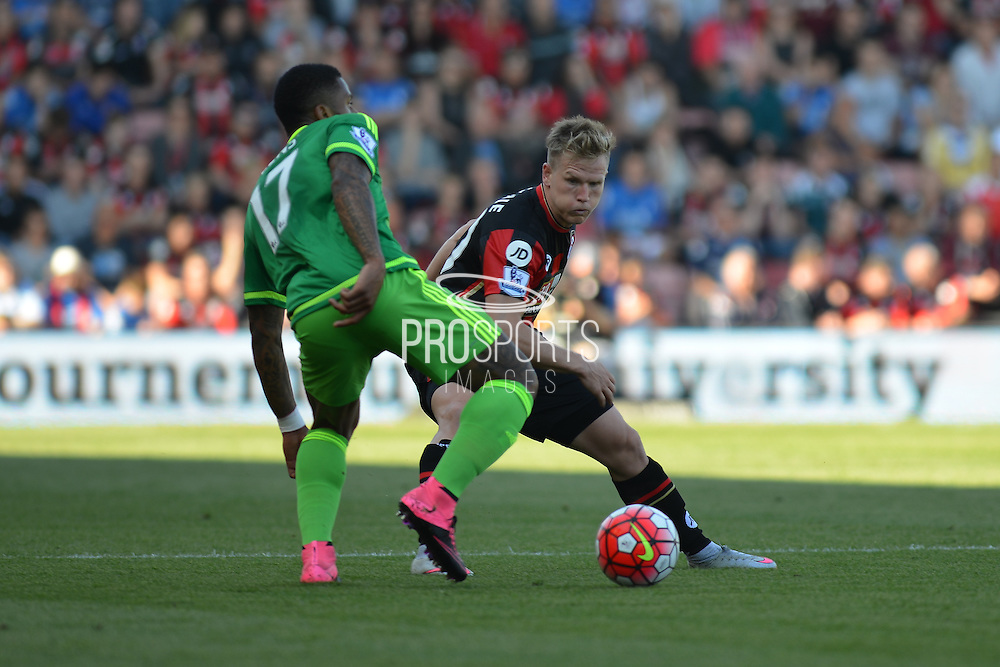 AFC Bournemouth's midfielder Matt Ritchie tackles Sunderland AFC midfielder Jeremain Lens during the Barclays Premier League match between Bournemouth and Sunderland at the Goldsands Stadium, Bournemouth, England on 19 September 2015. Photo by Mark Davies.