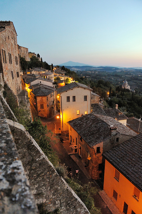Montepulciano, Tuscany, Italy. View from the Piazza S. Francesca S.W. toward Monte Amiata mountain in distance. Summer evening