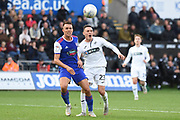 Swansea City defender Connor Roberts (23) and Ipswich Town defender Jonas Knudsen (3) battle for the ball during the EFL Sky Bet Championship match between Swansea City and Ipswich Town at the Liberty Stadium, Swansea, Wales on 6 October 2018.
