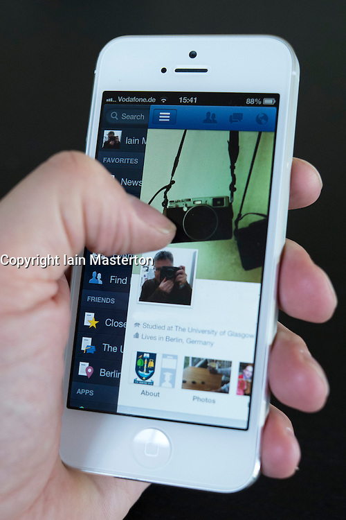 Detail of new iPhone 5 smart phone screen showing Facebook profile in Timeline