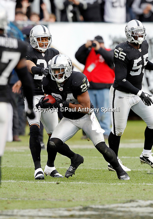 Oakland Raiders safety Michael Huff (24) intercepts a third quarter pass during the NFL week 16 football game against the Indianapolis Colts on Sunday, December 26, 2010 in Oakland, California. The Colts won the game 31-26. (©Paul Anthony Spinelli)