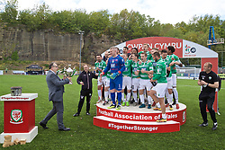 RHOSYMEDRE, WALES - Sunday, May 5, 2019: The New Saints' captain goalkeeper Paul Harrison receive the trophy from the Football Association of Wales President Kieran O'Connor after the FAW JD Welsh Cup Final between Connah's Quay Nomads and The New Saints at The Rock. The New Saints won 3-0. (Pic by David Rawcliffe/Propaganda)