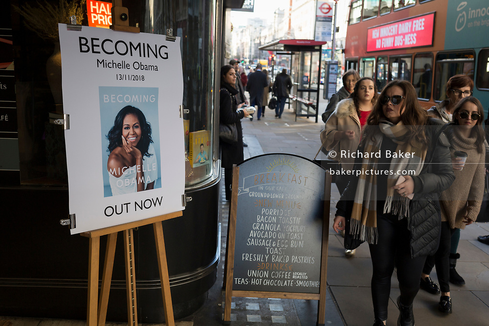 Outside Waterstones in Piccadilly, women walk past a publicity board for the eagerly-anticipated bestselling title, 'Becoming' by the former First Lady of the United States, Michelle Obama, before her publicity tour of the UK, on 13th November 2018, in London, England.