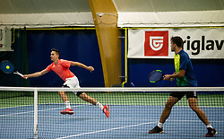 Aljaz Jakob Kaplja (R) and Bor Muzar Schweiger playing final match during Slovenian men's doubles tennis Championship 2019, on December 29, 2019 in Medvode, Slovenia. Photo by Vid Ponikvar/ Sportida