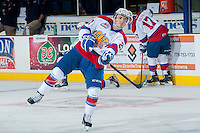 KELOWNA, CANADA - NOVEMBER 9: Ben Carroll #22 of the Edmonton Oil Kings takes a shot during warm up against the Kelowna Rockets on November 9, 2013 at Prospera Place in Kelowna, British Columbia, Canada.   (Photo by Marissa Baecker/Shoot the Breeze)  ***  Local Caption  ***