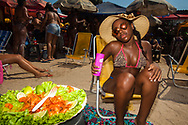 Rio de Janeiro, Brazil<br /> A young lady enjoys her cocktail and shrimp at Piscin&atilde;o de Ramos (Big Pool of Ramos). It's an artificial beach in the heart of Favela da Mar&eacute; (shanty town), in the North of Rio de Janeiro. The pool was built as a way to give a refreshing option to the people of the favelas. Before the Piscin&atilde;o, they had to face long hours of travel in crowded buses in order to go to the more well known beaches such as Copacabana and Ipanema, nice neighbourhoods of Rio de Janeiro.