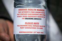 © Licensed to London News Pictures. 23/05/2016. Northallerton UK. Picture shows a protesters bottle of water with a fracking warning. A decision is expected today at Northallerton County Hall on wether to allow UK firm Third Energy to frack for shale gas in Kirby Misperton. Photo credit: Andrew McCaren/LNP