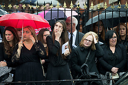 © Licensed to London News Pictures . 15/07/2016 . Bolton , UK . Mourners in the street outside the church after the service .  The funeral of Special Constable Samantha Derbyshire at St Mary's RC Church in Horwich , Bolton. Derbyshire was struck and killed by an HGV on the M61 motorway following a collision , in the early hours of Monday 11th July 2016 . Photo credit : Joel Goodman/LNP