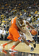 November 29, 2011: Iowa Hawkeyes forward Melsahn Basabe (1) tries to drive around Clemson Tigers forward/center Devin Booker (31) during the first half of the NCAA basketball game between the Clemson Tigers and the Iowa Hawkeyes at Carver-Hawkeye Arena in Iowa City, Iowa on Tuesday, November 29, 2011. Clemson defeated Iowa 71-55 in the Big Ten-ACC Challenge game.