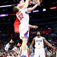 12 December 2016: Portland Trail Blazers center Mason Plumlee (24) is fouled by LA Clippers forward Blake Griffin (32) during the LA Clippers 121-120 victory over the Portland Trail Blazers, at the Staples Center, Los Angeles, California, USA.