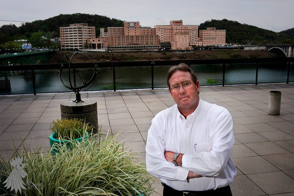 David M. Hill, Senior Director of South Waterfront Development for the city of Knoxville, in front of the hospital that is the current centerpiece of the mile-and-a-half development along the Tennessee River.