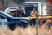 An investigator looks over the scene at a construction accident in Saratoga Springs where a 31-year old male died as the result of his injuries from a piece of heavy roadway machinery, Tuesday, Nov. 27, 2012.
