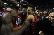Ole Miss' Murphy Holloway (31), Ole Miss' Reginald Buckner (23) and Ole Miss' Marshall Henderson (22) celebrate beating Florida in the SEC championship game at Bridgestone Arena in Nashville, Tenn. on Sunday, March 17, 2013. Ole Miss won 66-63.