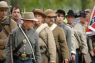 Confederate soldiers march back to their camp during a Civil War reenactment hosted by the 124th New York State Volunteers at the Orange County Farmers Museum on Sept. 23, 2006.