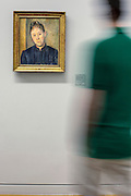 People looking at Cezanne painting in permanent collection of Granet museum in Aix-en-Provence, France.