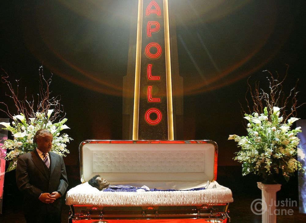 The Rev. Al Sharpton (L) stands next to the body of the late James Brown (R) during a public viewing on the stage of the Apollo Theater in the Harlem neighborhood of New York, New York on Thursday 28 December 2006.