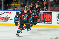 KELOWNA, CANADA - OCTOBER 23:  Conner Bruggen-Cate #20 and Kyle Topping #24 of the Kelowna Rockets skate against the Swift Current Broncos on October 23, 2018 at Prospera Place in Kelowna, British Columbia, Canada.  (Photo by Marissa Baecker/Shoot the Breeze)