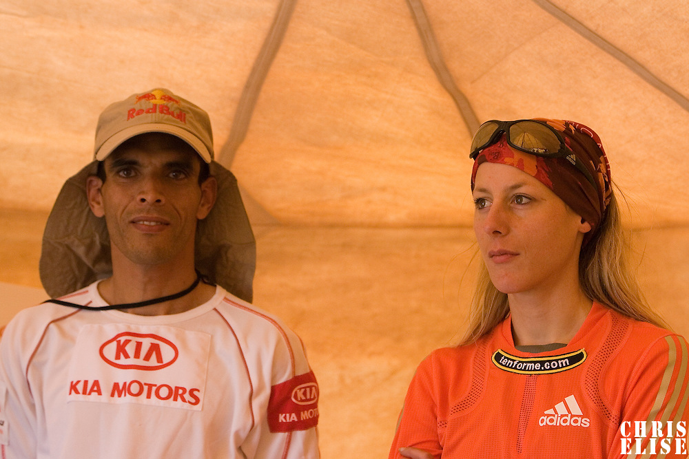 24 March 2007: 2006 winner Geraldine Courdesses of France (left) stands next to 2006 winner Lahcen Ahansal of Morocco during a press conference the day before the beginning of the 22nd Marathon des Sables, a 6 days and 151 miles endurance race with food self sufficiency across the Sahara Desert in Morocco. Each participant must carry his, or her, own backpack containing food, sleeping gear and other material.