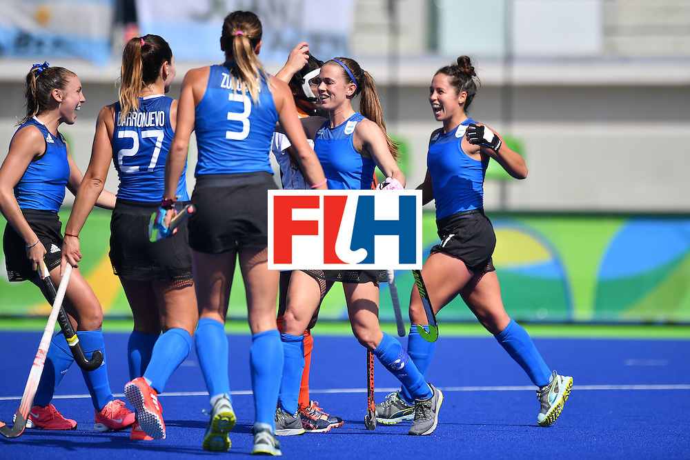 Argentina's Carla Rebecchi celebrates scoring with her team-mates during the women's field hockey Argentina vs India match of the Rio 2016 Olympics Games at the Olympic Hockey Centre in Rio de Janeiro on August, 13 2016. / AFP / Carl DE SOUZA        (Photo credit should read CARL DE SOUZA/AFP/Getty Images)