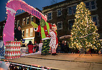 """The """"Who-ville"""" float by Bank of New Hampshire waves to the crowd during the annual Holiday Parade through downtown on Saturday evening.  (Karen Bobotas/for the Laconia Daily Sun)"""