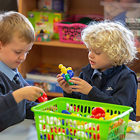 Emmet Reily and Finlay Meehan play together on their First day at school at Scoil Na Mainistreach Quin Dangan