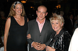 Left to right, GAY LONGWORTH, her husband ADAM SPIEGEL and GLORIA HUNNIFORD at a party to celebrate the publication of 'Next To You' - Caron's Courage remembered by her mother Gloria Hunniford held on Caron's birthday at The Hilton Park Lane, London on 5th Octobe 2005.<br /><br />NON EXCLUSIVE - WORLD RIGHTS