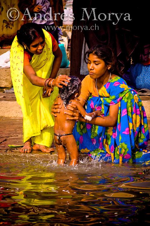 India Varanasi Hindu ilgrims washing in the holi Ganges River, Varanasi, India Image by Andres Morya