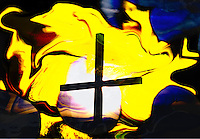 cross of light: a cross on bright and floating yellow sky background with light