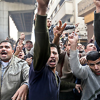 Demonstrators protest following Friday prayers in Islamic Cairo, Egypt. January 2011.