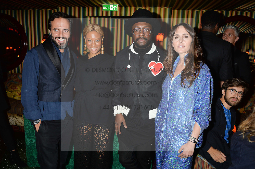 Left to right, JOSE NEVES, STEPHANIE HORTON, WILL.I.AM and TANIA FARES at a party hosted by fashion website Farfetch to launch i.am + EPs headphones hosted by Will.i.am at Loulou's, 5 Hertford Street, London on 16th September 2016.