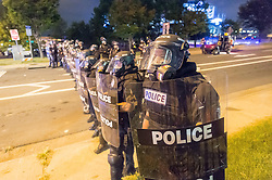 September 22, 2016 - Charlotte, North Carolina, United States of America - September 22, 2016 - Charlotte, NC, USA - Riot police stand their ground during a third day of protests in Charlotte, North Carolina on Thursday, Sept. 22, 2016. This is the third day of protests that erupted after a police officer's fatal shooting of an African-American man Tuesday afternoon and the first full day of a declared State of Emergency by the governor. (Credit Image: © Sean Meyers via ZUMA Wire)