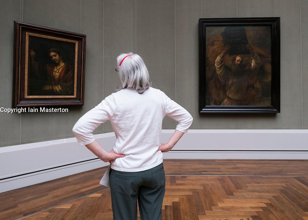 Woman looking at paintings inside Gemaldegalerie museum, at Kulturforum in Berlin, Germany