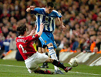 Photo: Ed Godden.<br />Manchester United v Wigan Athletic. The Carling Cup Final. 26/02/2006. Gary Neville (L) and Wigans Lee McCulloch collide.