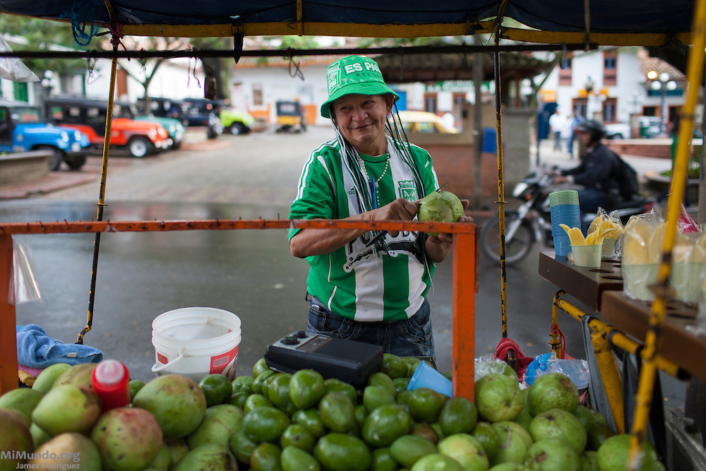 Adolfo Garzón, 50, sells fruits in his home city of Ciudad Bolivar and claims to be the city's number one fan of Atletico Medellin, a football (soccer) club from Antioquia's capital city of Medellin. Mr. Garzón proudly wears the team's colors everyday and often recalls the glory days when Atletico Medellin won the 1989 Libertadores Cup - South America's most important club tournament. Ciudad Bolivar, Antioquia, Colombia. September 26, 2013.