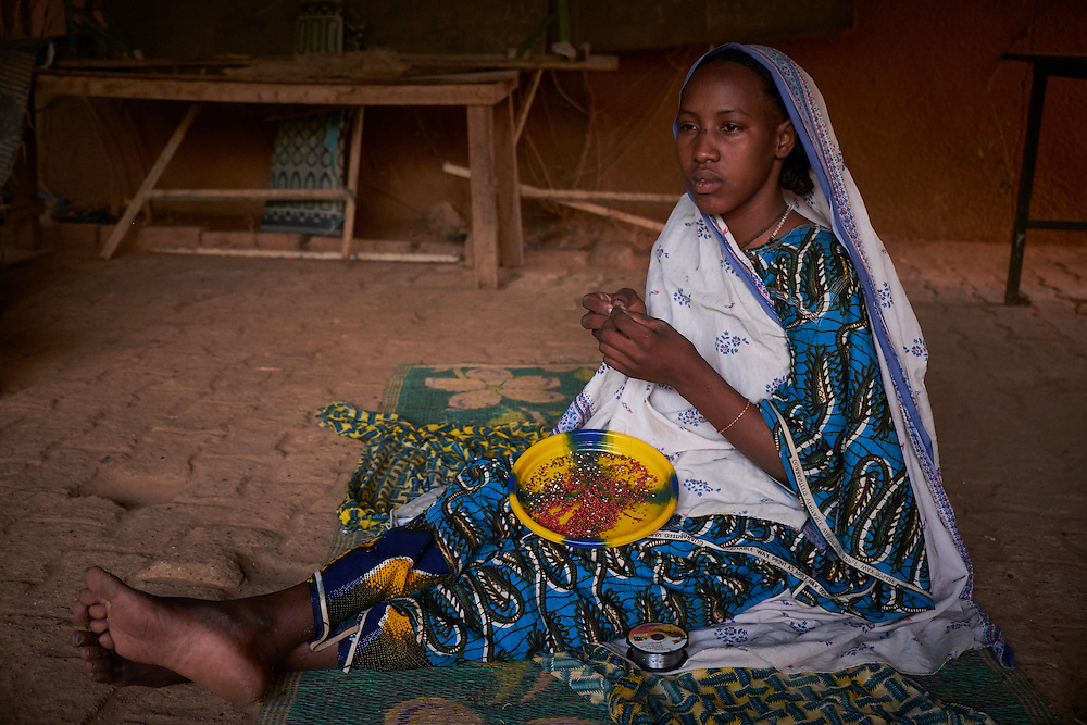 Aichatou Moussa, 16 years old at the Centre of Female Victims of Fistula. Aichatou has been treated and accommodated at the centre for two weeks and may wait up to three months before her surgery. They come from Sabangori Aballak about 300km from Niamey. <br /> <br /> Aichatou - 'After I gave birth it began to hurt a lot and and I believed I was going to die and was so ashamed to not be able to control it (the urinating). After the operation it still hurts but not like before. I hope I will recover, I heard of stories with other women who came with more complicated cases than mine and they recovered. I am scared now of having the next baby though. For my children I want them to go to school because  I never did. &lsquo;<br /> <br /> Aichatou&rsquo;s father - 'Aichatou never went to school, there is not even a school in the village. She had the fistula after giving birth less than two months before to a stillborn baby. We returned to the village and one week later when we saw that the urine was not stopping we were referred to Niamey's main hospital. We were then referred to the NGO who the hospital has a partnership with in treating women with fistula.'