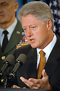 President Bill Clinton makes a statement on the Kosovo peace agreement and thanks NATO and US Forces for their efforts as Joint Chief of Staff General Hugh Shelton looks on in the White House briefing room June 10, 1999 in Washington, DC.