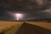 Long exposure night photograph of lightning and surrounding farm fields, Nature Photography, Lightning Images, Farmland Photograph.