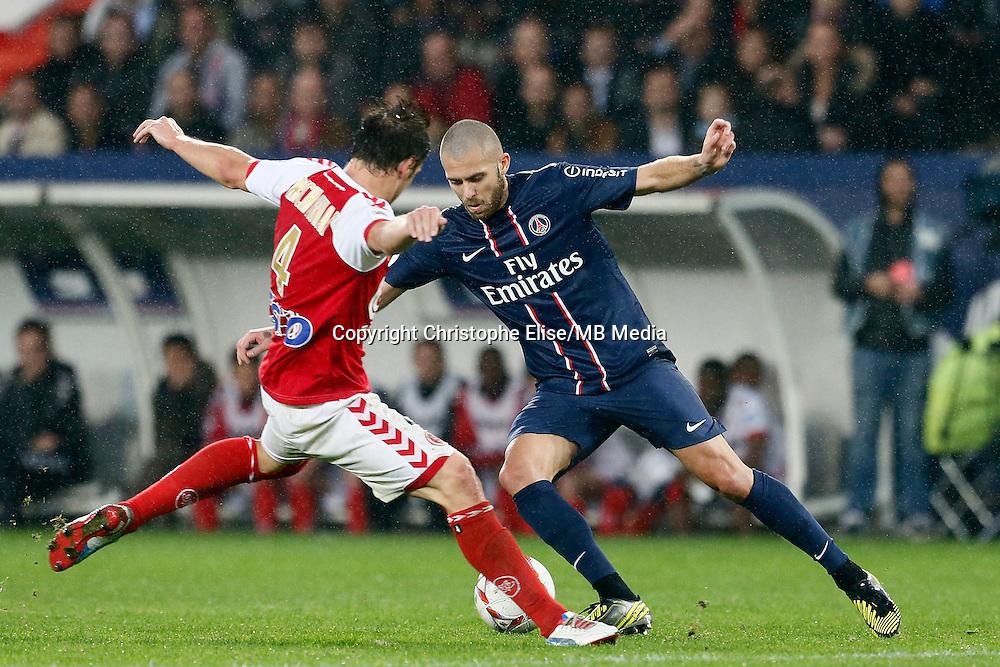 FOOTBALL - FRENCH CHAMPIONSHIP 2012/2013 - L1 - PARIS SAINT GERMAIN VS REIMS - 20/10/2012 - GRZEGORZ  KRYCHOWIAK (REIMS) JEREMY MENEZ (PARIS SAINT-GERMAIN)