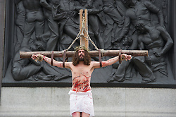 © London News Pictures. 03/04/15. London, UK. The Passion of Jesus is performed in Trafalgar Square, central London on Good Friday. Photo credit: Laura Lean/LNP
