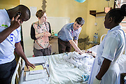 Dr Godfrey Kambanga, Dr Siobhan Neville and Dr Peter O'Reilly attend to patients on the Intensive care ward during the daily rounds. St Walburg's Hospital, Nyangao. Lindi Region, Tanzania.