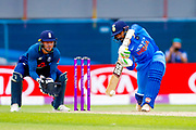 India ODI all rounder Dinesh Karthik  hits a boundary off the bowling of England ODI bowler Adil Rashid  during the 3rd Royal London ODI match between England and India at Headingley Stadium, Headingley, United Kingdom on 17 July 2018. Picture by Simon Davies.