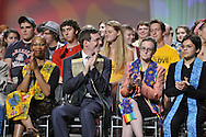 Synergy - Bridging. Adult speakers applaud newly bridged young adults.© 2012 Nancy Pierce/UUA