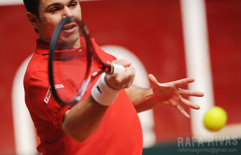 Switzerland's Stanislas Wawrinka returns the ball against Spain's Nicolas Almagro during their Davis Cup World Group first round tennis match in Logrono, North of Spain,  on March 5, 2010. Wawrinka won the match. PHOTO/Rafa Rivas