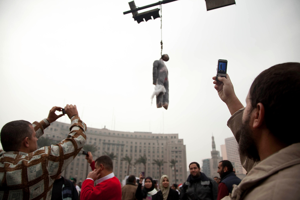 Anti-government protesters gather in Tahrir Square in Cairo, Egypt, on Saturday, Feb. 5, 2011.